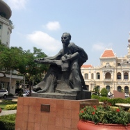 Ho Chi Minh with child statue in front of City Hall.