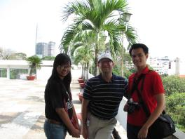 Me with My, and Khoa on the roof terrace of the Reunification Palace.